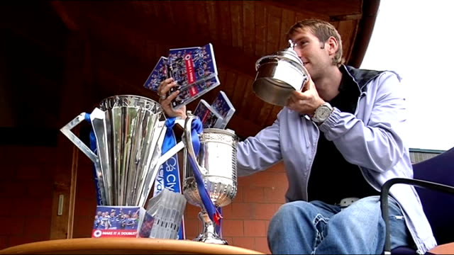 Kirk Broadfoot launches Rangers DVD SCOTLAND Glasgow EXT Closeup of SPL trophy and Scottish FA Cup trophy Kirk Broadfoot poses with trophies and...