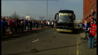 Rangers beat Celtic SCOTLAND Glasgow Ibrox Park EXT Celtic team bus arriving at the ground to jeers from Rangers supporters Crowd around players...