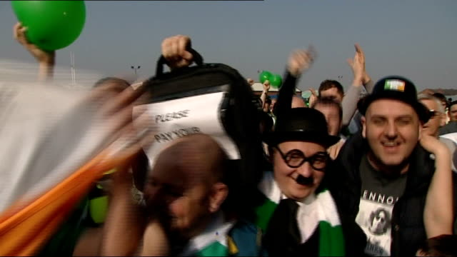 Rangers beat Celtic SCOTLAND Glasgow Ibrox Park EXT Celtic fans singing and holding up briefcase with message reading 'Please Pay Your Taxes' SOT...