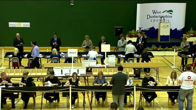 ITV News Special Clean Feed 2145 2300 West Dunbartonshire INT Ballot box being emptied and votes counted / people counting ballots in counting hall...