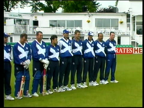Scottish team lined up on pitch for photocall PAN LR BV Scottish player practicing batting in nets Graham Dilley interviewed SOT Players just...