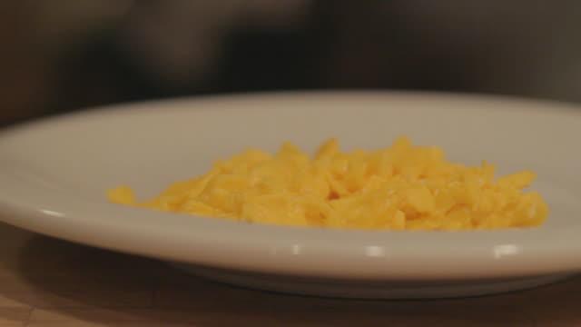 Scrambled eggs on a white plate 3