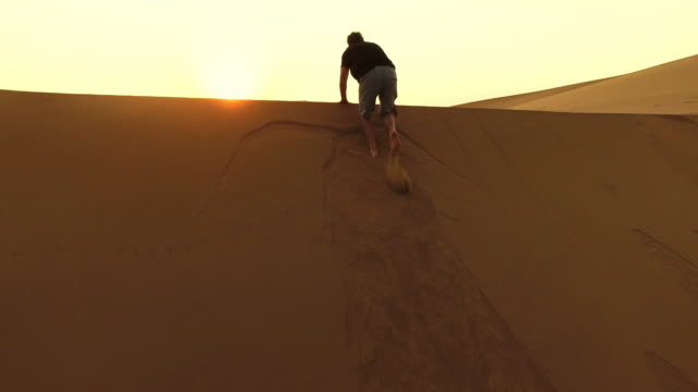 Scrambling over the dunes at dawn