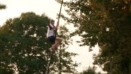 Scrambling up a ten metre long pole as it glides over a pool of water might not be everyone's idea of fun but watching the traditional Dutch sport of...