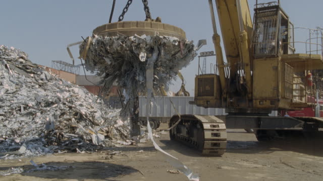 WS SLO MO Scrap metal being dropped by giant magnet / Los Angeles, California, USA