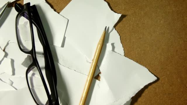 Scrap paper and pencil, pen, glasses