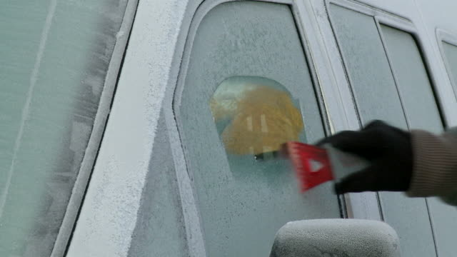MS Scraping ice of car side window / Kastel, Rhineland-Palatinate, Germany