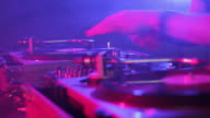 CU SELECTIVE FOCUS PAN DJ scratching records in nightclub, view of hands / London, United Kingdom