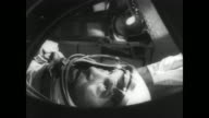 'GREAT FEATS IN SPACE HISTORY' / pan of space center and surrounding area at Cape Canaveral / Lieutenant Colonel Thomas Stafford seated with...