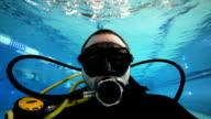 Scuba diver in a swimming pool
