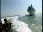 Scud missile shipment intercepted LIB Royal Navy ship seen from Royal Marines ofshore boat TRACK Royal Marines on board boat TRACK Marines riding in...