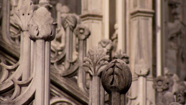 Sculpted flowers decorate stone buttresses. Available in HD.