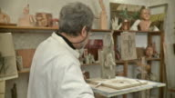 HD DOLLY: Sculptor Artist Making Religious Statue