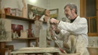 HD DOLLY: Sculptor Artist Modeling Clay