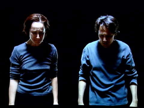 New video installation Video art installation by Bill Viola entitled 'Silent Mountain' showing man and woman dressed in grey crying