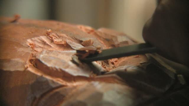 ECU Sculptor chiseling wood / Havana, Cuba