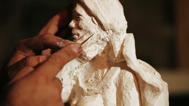 Sculptor work with gypsum