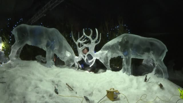 Sculptors are putting the finishing touches to winter ice sculptures at Edinburgh's Christmas market including life sized stags bears and historical...