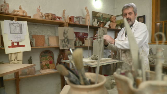 HD DOLLY: Sculpture Artist Making Clay Statue