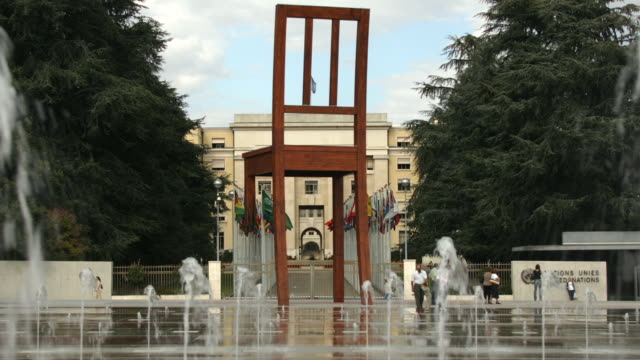 T/L WS Sculpture of chair and fountains in front of United Nations Office, United Nation Square, Geneva, Switzerland