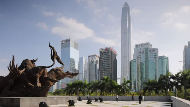 Sculpture outside Stock Exchange with Ping An Finance Centre and skyscrapers, Futian, Shenzhen, Guangdong, China, Asia