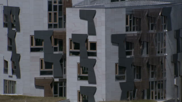 Sculptures decorate the outer walls of the Scottish Parliament Building Available in HD.