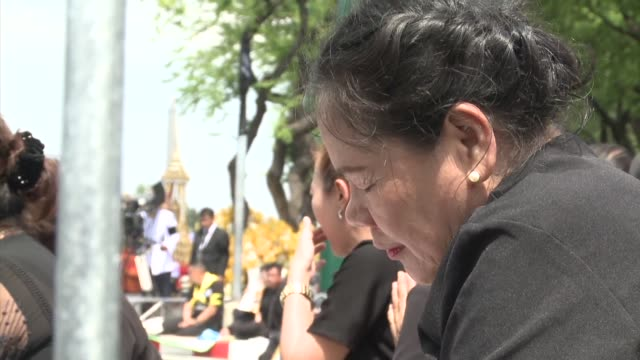 A sea of black clad mourners mass across Bangkok's historic heart as funeral rituals begin for King Bhumibol Adulyadej a revered monarch whose...