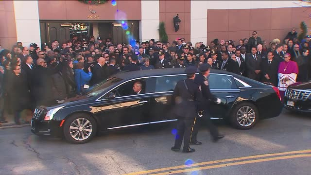A sea of blue flooded the streets around a Queens church Saturday morning as thousands of police officers said goodbye to one of two New York...