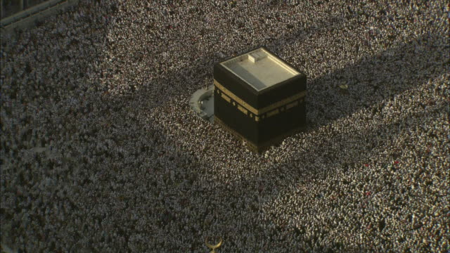 A sea of Islamic pilgrims gather around the Kaaba in Mecca.