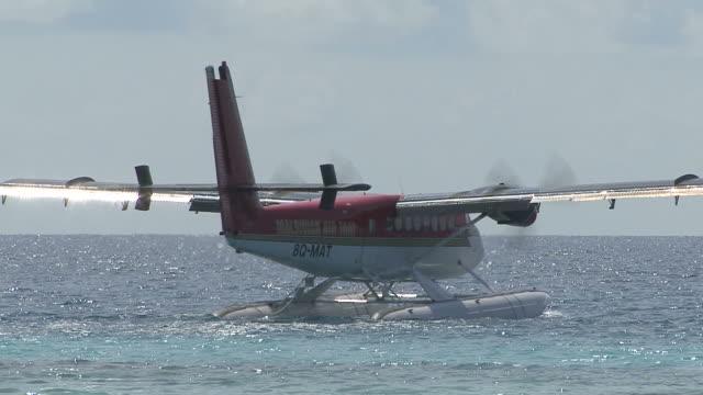 sea plane gets ready to take off, Maldives