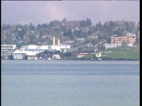 Sea plane landing on harbor water
