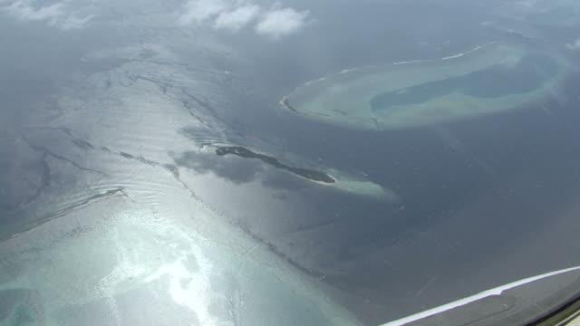 sea plane over atolls, Maldives
