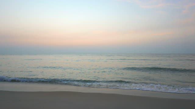 Sea wave sunrise on the beach