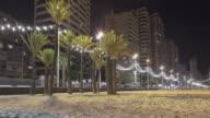 Seafront promenade of Benidorm at night time lapse