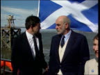 SCOTLAND Firth of Forth LA GV Forth Bridge PAN to Sean Connery standing on boat next Gordon Brown MP as St Andrew's flag flies behing them Edinburgh...