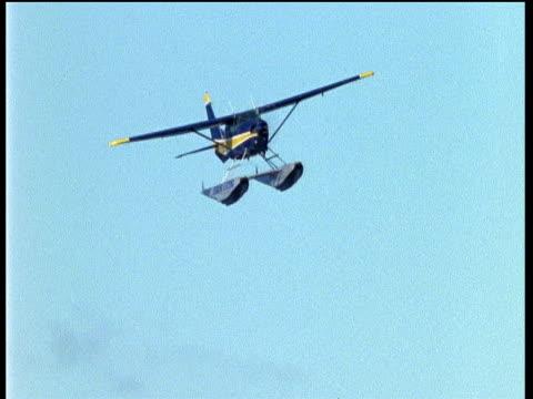 Seaplane in flight bright blue sky in background