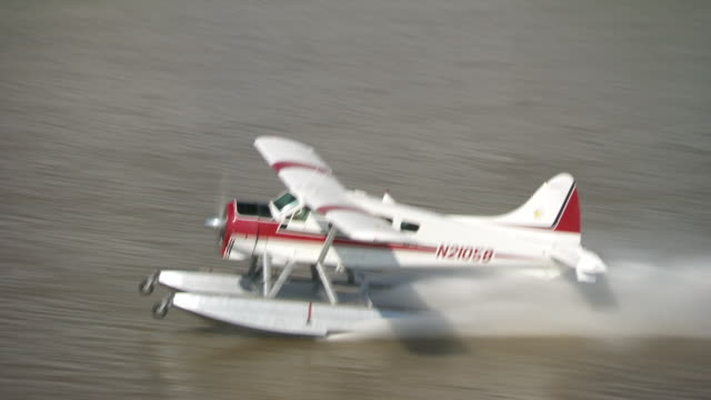 AERIAL ZI ZO Seaplane landing on mississippi river/ New Orleans, Louisiana, United States
