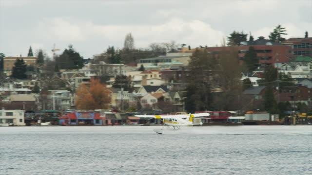 WS TS Seaplane taking off from harbor / Seattle, Washington, USA
