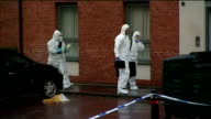 Search for missing boy Mikaeel Kular continues Forensic officer entering Kular family home Police officers searching large refuse bin in street