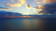 seascape on cloud background at sunset,  aerial video