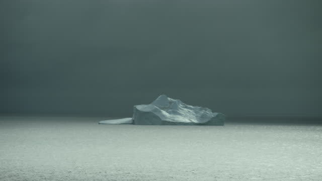 Seascape With Iceberg On Cloudy Day