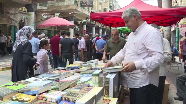Seated at tables with glasses of tea in the heart of Baghdad's bookshop district the customers of Shabandar cafe have watched 100 years of Iraq's...