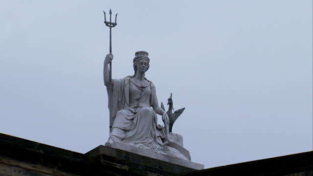 A seated woman holding a trident tops Victoria Hall. Available in HD.