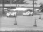 Sebring 12 Hour Grand Prix of Endurance Sebring Florida aerial shot of race cars on racetrack panning TLS Daimler SP250 Porsche 718 Elva Courier...
