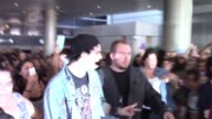 5 Seconds Of Summer arrive at LAX Airport and greeted by fans in Los Angeles Celebrity Sightings in Los Angeles CA on