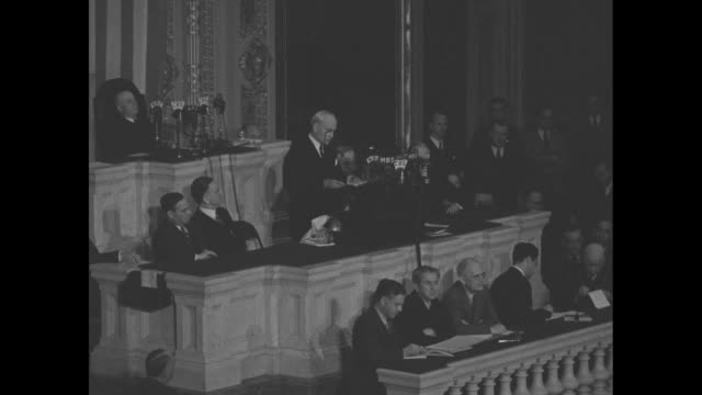 US Secretary of State Cordell Hull stands before bank of radio microphones as he addresses a joint session of Congress about his attendance at the...