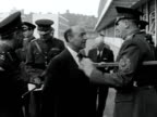 Secretary of state for war John Profumo arrives at the new Knightsbridge army barracks for a tour