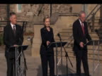 US Secretary of State Hillary Clinton emerges from Stormont Castle with First Minister Peter Robinson and Deputy First Minister Martin McGuinnesson...