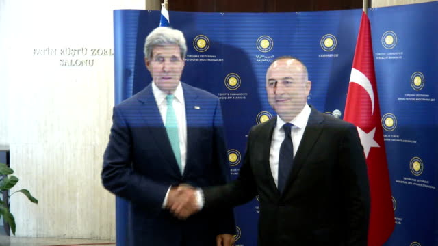 S Secretary of State John Kerry and Turkish Foreign Minister Mevlut Cavusoglu meet and speak to media prior to their meeting in Ankara Turkey on...