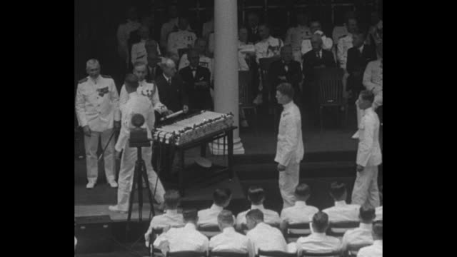 US Secretary of the Navy Charles Francis Adams III finishes speaking / interior of building with crowd of thousands / high angle view of midshipmen...